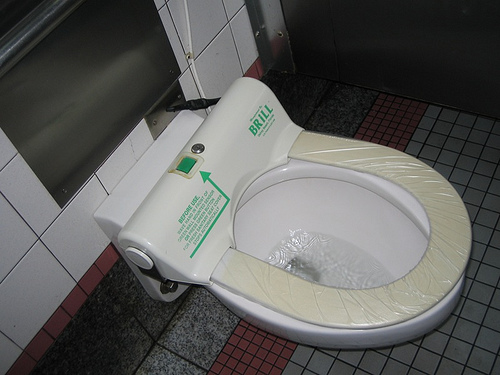 automatic toilet seat cover dispenser